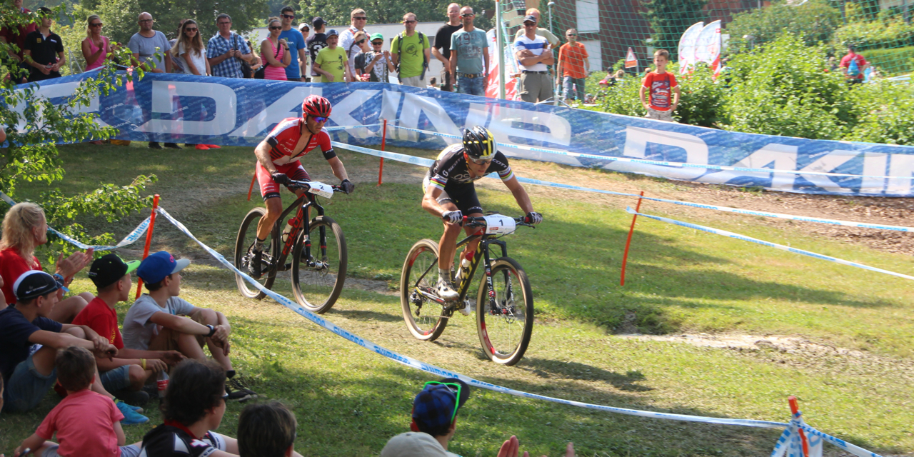 http://acrossthecountry.net/wp-content/uploads/2015/07/Nino-Schurter_Florian-Vogel_corner_SM15_Langendorf_acrossthecountry_mountainbike_by-Goller.jpg